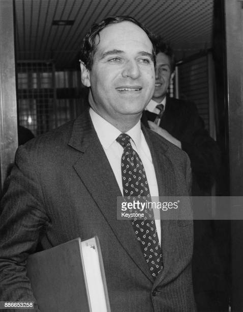 British politician Leon Brittan the Secretary of State for Trade and Industry leaves his office for the House of Commons in London during the debate...