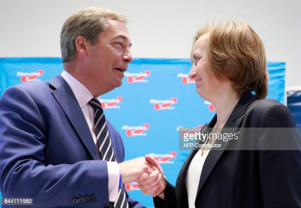 British politician Nigel Farage, former leader of the UK Independance Party shakes hands with deputy party leader of the AFD Beatrix von Storch after...