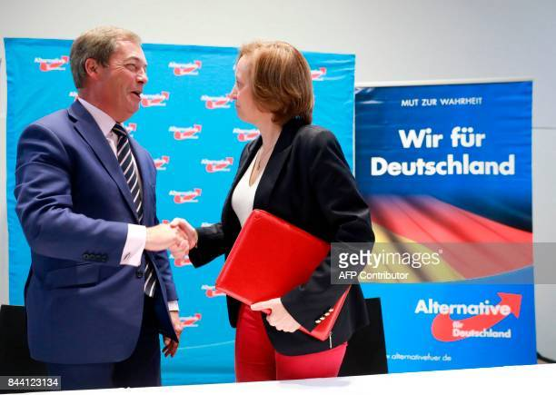 British politician Nigel Farage former leader of the UK Independance Party and deputy party leader of the AFD Beatrix von Storch shake hands after a...