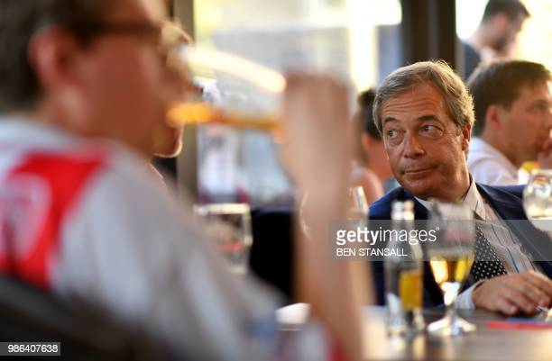 British politician Nigel Farage looks on at The Beer Factory Bar in Brussels on June 28 as he watches the Russia 2018 World Cup Group G football...