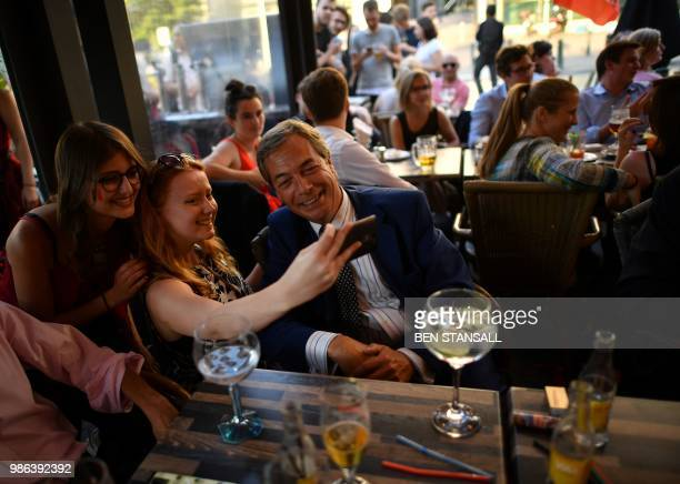 British politician Nigel Farage poses for a 'selfie' at The Beer Factory Bar in Brussels on June 28 as he watches the Russia 2018 World Cup Group G...