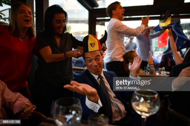 TOPSHOT British politician Nigel Farage reacts after a goal for Belgium at The Beer Factory Bar in Brussels on June 28 as he watches the Russia 2018...