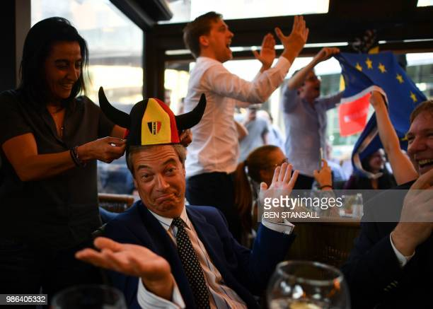 British politician Nigel Farage reacts after a goal for Belgium at The Beer Factory Bar in Brussels on June 28 as he watches the Russia 2018 World...