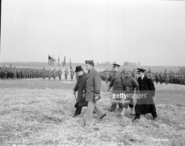 British politician Prime Minister Winston Churchill and American General and Supreme Allied Commander Dwight D Eisenhower along with others inspect...