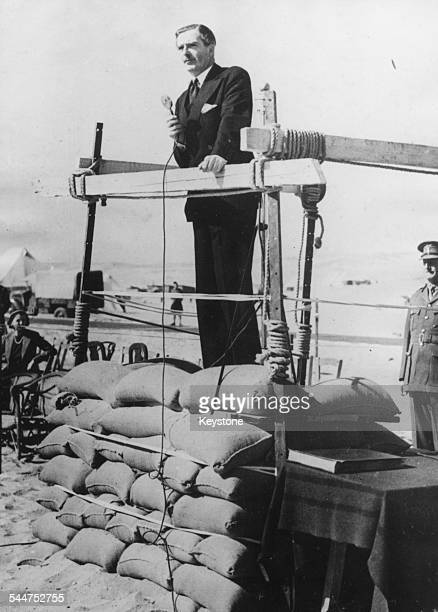 British politician Sir Anthony Eden giving a speech to ANZAC forces while standing on a makeshift stage made of sandbags Egypt February 23rd 1940