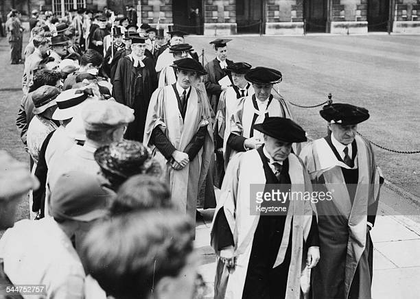 British politician Sir Anthony Eden with Sir John Anderson ExGovernor of Bengal wearing cap and gown as they receive honorary degrees at Cambridge...