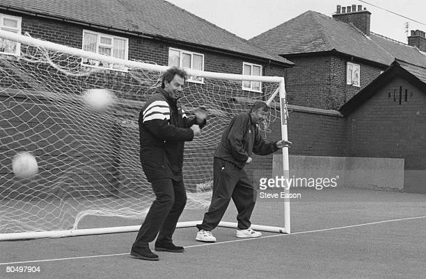 British politician Tony Blair leader of the Labour Party wearing a Newcastle United top playing football with Alex Ferguson of Manchester United 4th...