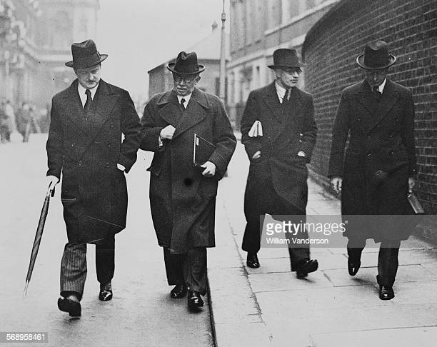 British politicians Duff Cooper, James Henry Thomas and Malcolm MacDonald, leaving a luncheon concerning the Locarno Treaty, Downing Street, London,...