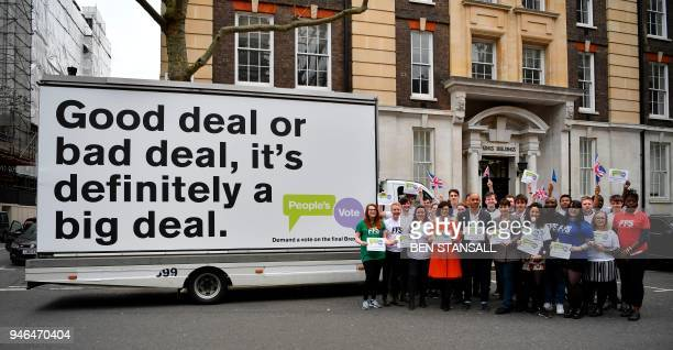 British politicians Labour Party MP Chuka Umunna Liberal Democrat MP Layla Moran and Green MP Caroline Lucas pose with activists in front of an...