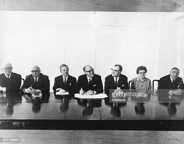 British politicians sit at a board room table as part of the first meeting of the Prices and Incomes Board R G Middleton Robert Willis Rt Hon Hilary...