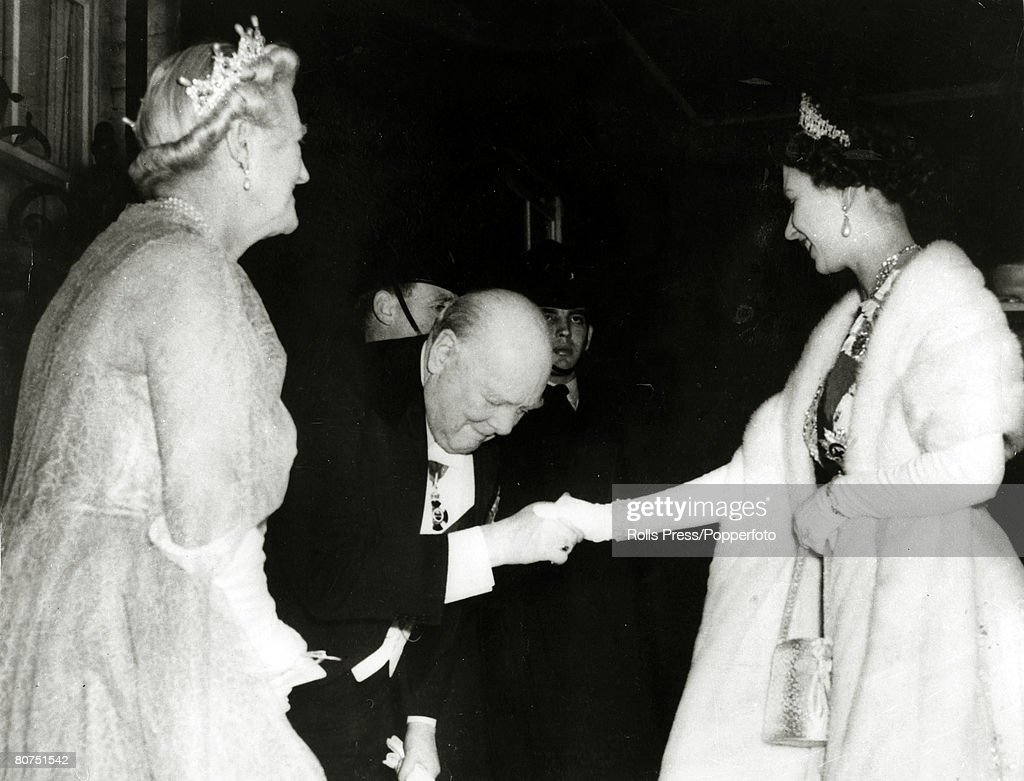 British Politics / Royalty pic: April 1955. Sir Winston Churchill, watched by Lady Churchill, greets H.M.Queen Elizabeth II as she arrives at No 10 Downing Street London. This at the time Sir Winston was to retire from political life at the age of 80. : News Photo