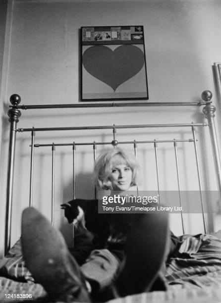 British pop artist Pauline Boty at home with her cat circa 1963