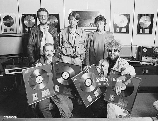 British pop duo Annie Lennox and David A Stewart of the Eurythmics at the RCA Records offices with the gold and platinum discs awarded for sales of...