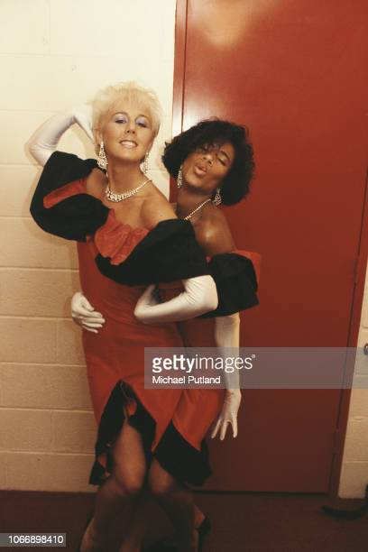British pop duo Pepsi & Shirlie, backing singers for Wham!, pictured backstage together during the Japanese leg of the group's 'The Big Tour' in...