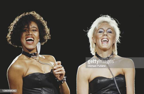 British pop duo Pepsi Shirlie perform live on stage as backing singers for Wham during the Japanese leg of the group's 'The Big Tour' in January 1985...