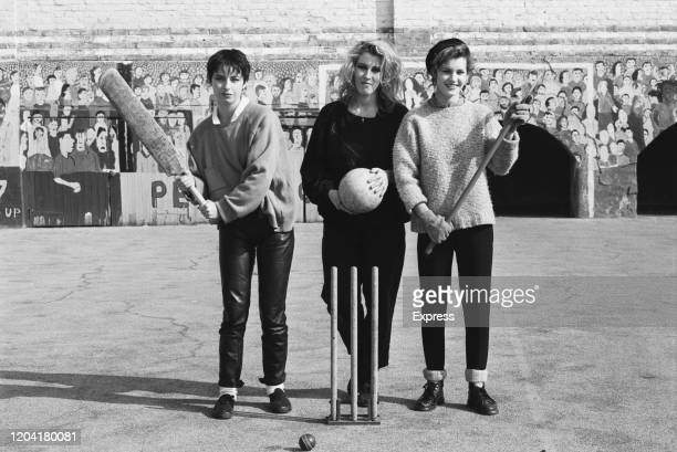 British pop group Bananarama holding sports equipment at the launch of a sex equality campaign for schools in London, England, 12th March 1985.