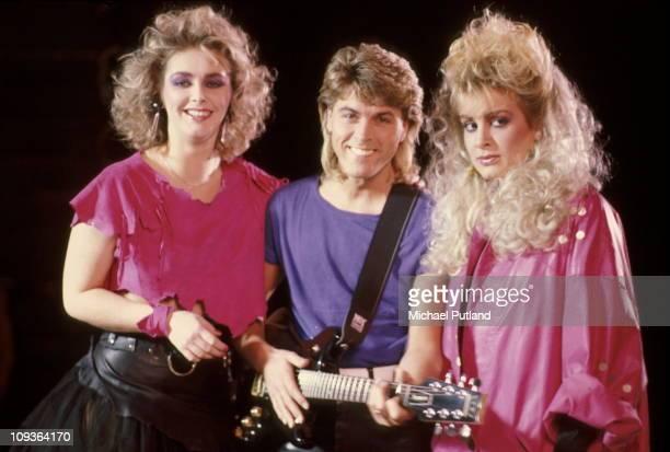 British pop group Bucks Fizz on the set of a video shoot for the single 'I Hear Talk' November 1984 Cheryl Baker Mike Nolan Jay Aston