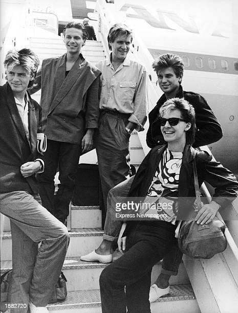 British pop group Duran Duran smile and laugh while posing on an airplane ramp before departing for Australia Heathrow Airport London England July 26...