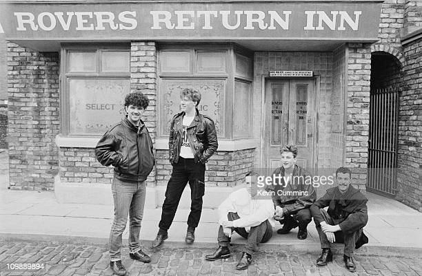 British pop group Frankie Goes To Hollywood pose outside the Rovers Return pub on the set of the TV soap opera 'Coronation Street' Manchester 1984...