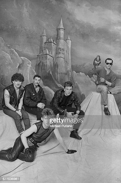 British pop group Frankie Goes To Hollywood posing with a falcon in front of a castle backdrop London FebruaryMarch 1983 Left to right drummer Peter...