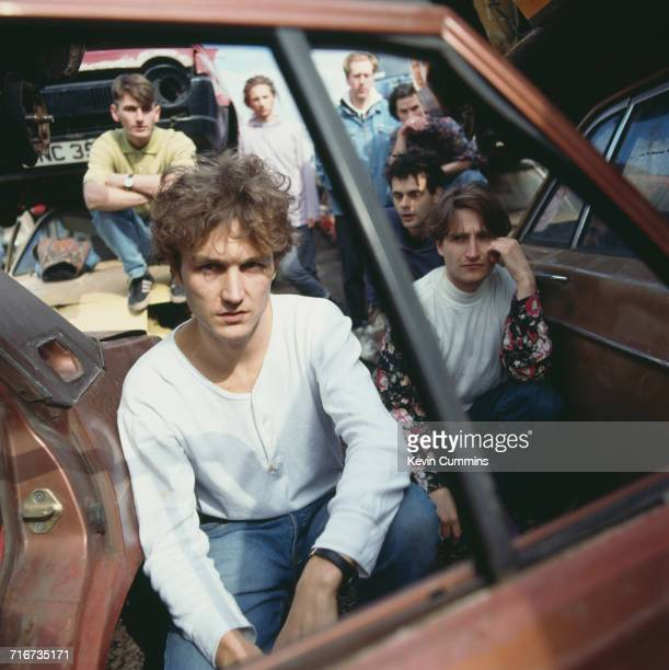 British pop group James posing in a scrapyard circa 1990 Clockwise from front Tim Booth Jim Glennie Mark Hunter David BayntonPower Larry Gott Andy...