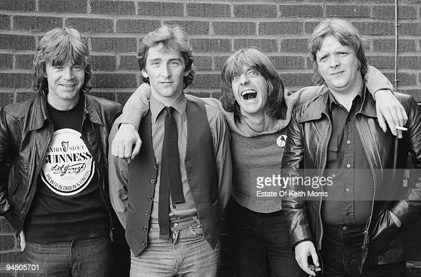 British pop group Rockpile London 1978 Left to right singer and guitarist Dave Edmunds singer and guitarist Terry Williams bassist and singer Nick...