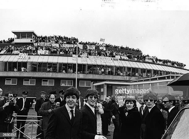British pop group The Beatles at Heathrow Airport before flying to America for a tour Original Publication People Disc HU0073