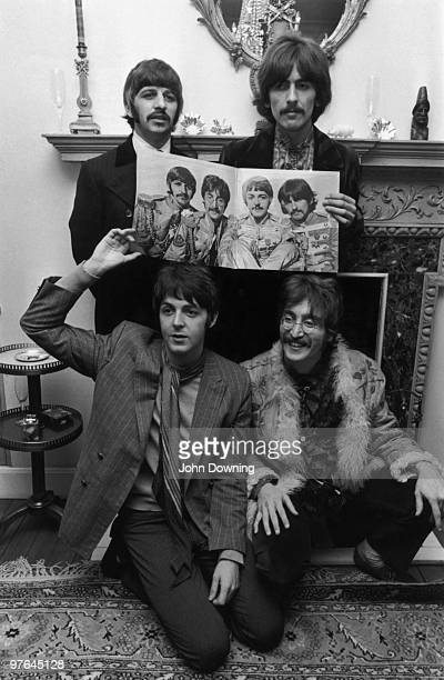British pop group The Beatles clockwise from top left Ringo Starr George Harrison John Lennon and Paul McCartney pose with the cover of their new...