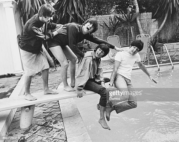 British pop group The Beatles clown about on the diving board of their Hollywood Hills hideout during their tour of Canada and the US, 28th August...