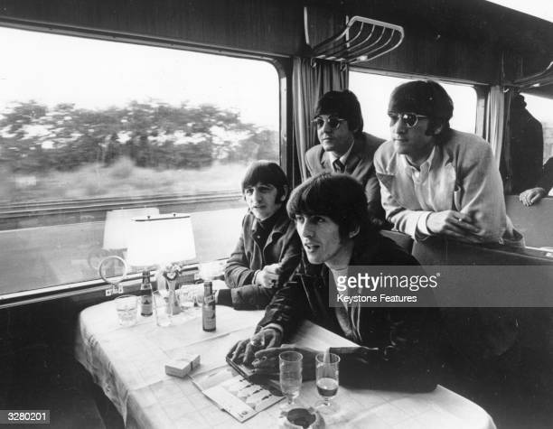 British pop group the Beatles John Lennon Paul McCartney George Harrison and Ringo Starr touring by train in Europe