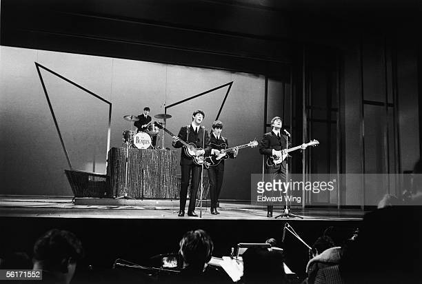 British pop group The Beatles on stage at the London Palladium, 3rd October 1963.