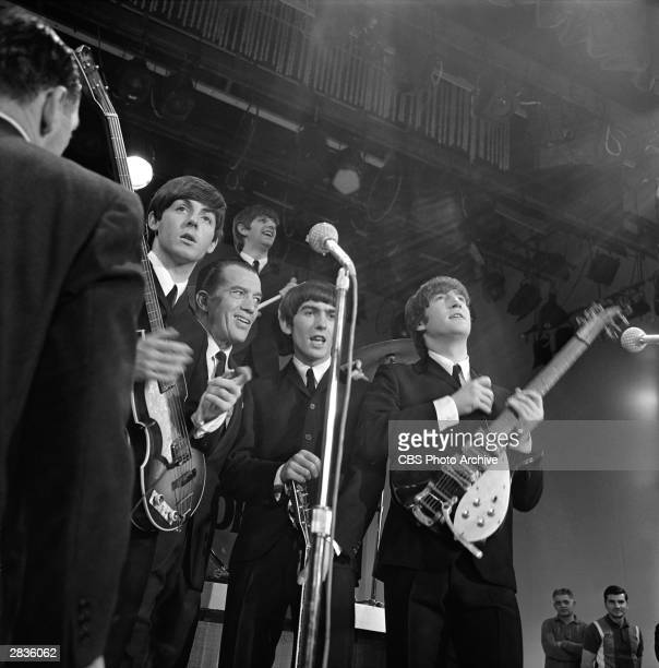 British pop group The Beatles pose after a performance on 'The Ed Sullivan Show' at Studio 50, New York, New York, February 9, 1964. Pictured are...