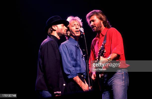 British pop group the Bee Gees perform onstage at the Poplar Creek Music Theater, Hoffman Estates, Illinois, July 31, 1989. Pictured are, from left,...