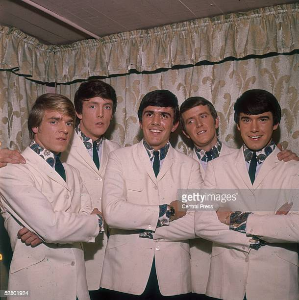 British pop group The Dave Clark Five wearing matching white suits and paisley shirts 1965 Left to right Lenny Davidson Dave Clark Rick Huxley Denis...