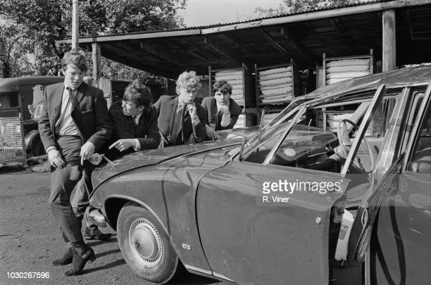 British pop group The Four Pennies with their wrecked car after an accident at Ryton UK 22nd September 1964