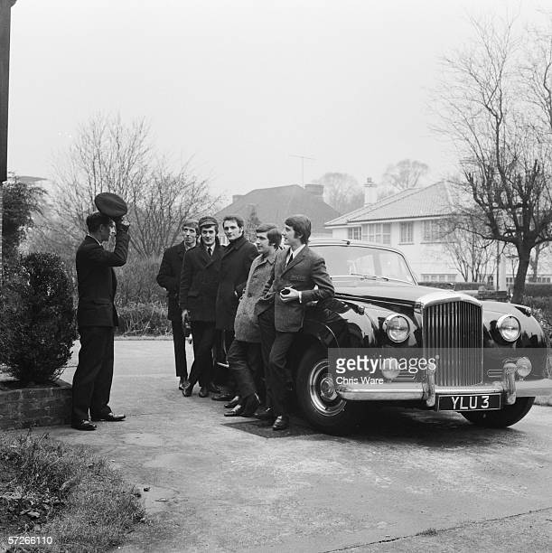 British pop group The Moody Blues with their driver and their Bentley outside their shared house in south London 12th Feb 1965