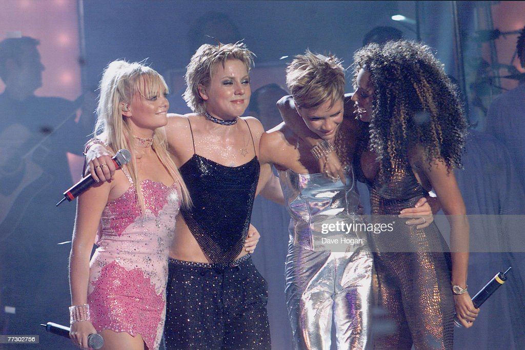 British pop group the Spice Girls (minus Geri Halliwell) collect the award for Outstanding Contribution at the Brit Awards, Earl's Court, 3rd March 2000. From left to right, Emma Bunton, Melanie Chisholm, Victoria Beckham and Melanie Brown.