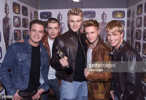 British pop group Westlife win the award for Best Pop Act at the Brit Awards at Earls Court on February 20 2002 in London