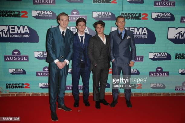 British pop rock band The Vamps Brad Simpson James McVey Connor Ball and Tristan Evans pose on the red carpet arriving to attend the 2017 MTV Europe...