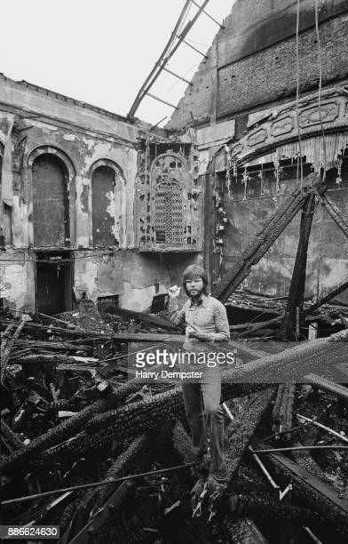 British pop singer actor and performer Cliff Richard standing in the rubble of the burnt out New Theatre in Bromley where he was supposed to perform...
