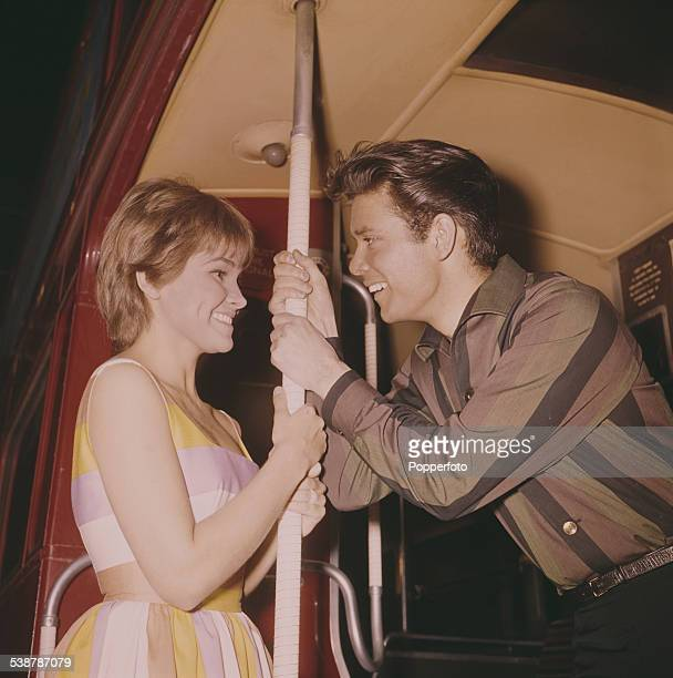 British pop singer and actor Cliff Richard and American actress Lauri Peters pictured together in character as Don and Barbara on the rear platform...