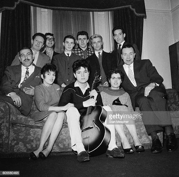 British pop singer Cliff Richard and his backing group The Shadows 4th February 1959 Clockwise from rear left Joe Lee Hank Marvin Tony Meehan Bruce...