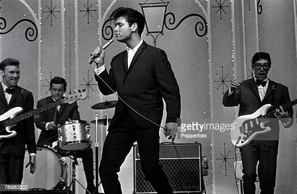 1963 British Pop singer Cliff Richard and his backing group The Shadows performing live on stage