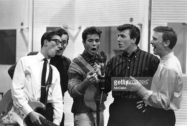 British pop singer Cliff Richard, centre, singing with backing band the Shadows at EMI Recording Studios in 1962.