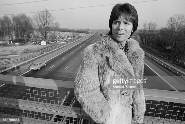 British pop singer Cliff Richard on a motorway bridge 25th February 1975