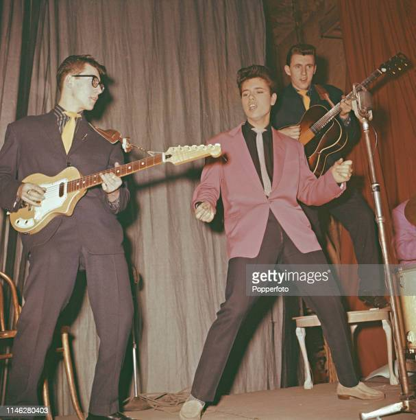 British pop singer Cliff Richard performs live on stage with, from left, Hank Marvin and Bruce Welch of The Shadows at a theatre in England in 1959....