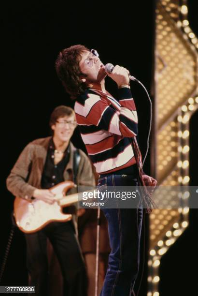 British pop singer Cliff Richard performs with guitarist Hank Marvin of the Shadows at a Royal Variety Performance rehearsal at the Theatre Royal on...