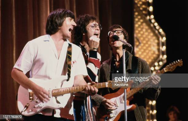 British pop singer Cliff Richard performs with guitarists Bruce Welch and Hank Marvin of the Shadows at a Royal Variety Performance rehearsal at the...