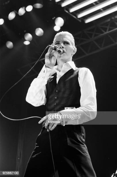 British pop singer David Bowie performing on stage during the first of six concerts at the Empire Pool Wembley dressed in a Dolce Vita outfit as part...