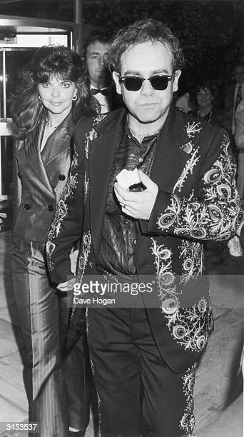 British pop singer Elton John with his wife Renate Blauel August 1986